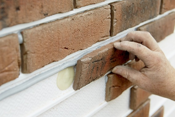 Inserting brick slips